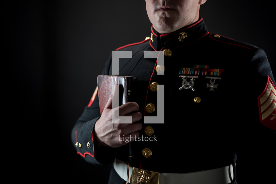 a Marine holding a Bible