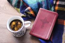 coffee and Bible on a plaid flannel blanket