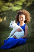 a child holding a lamb