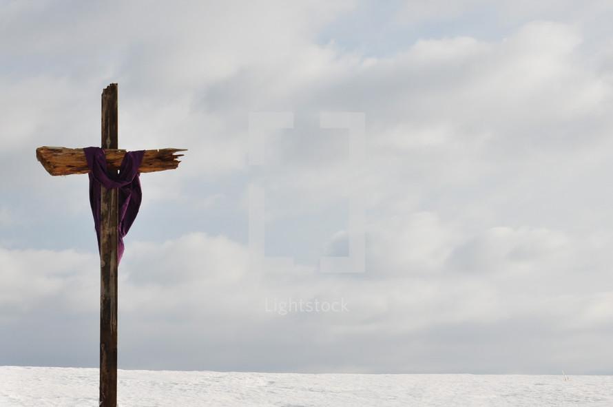 Veiled cross by the ocean.