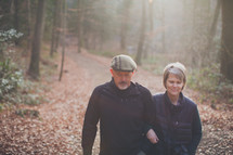 couple walking arm and arm outdoors on a trail