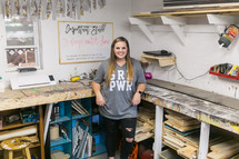 A young woman in a craft room