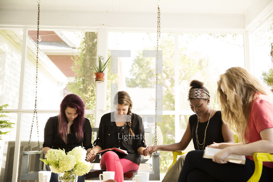 woman's group Bible study discussing scripture on a porch