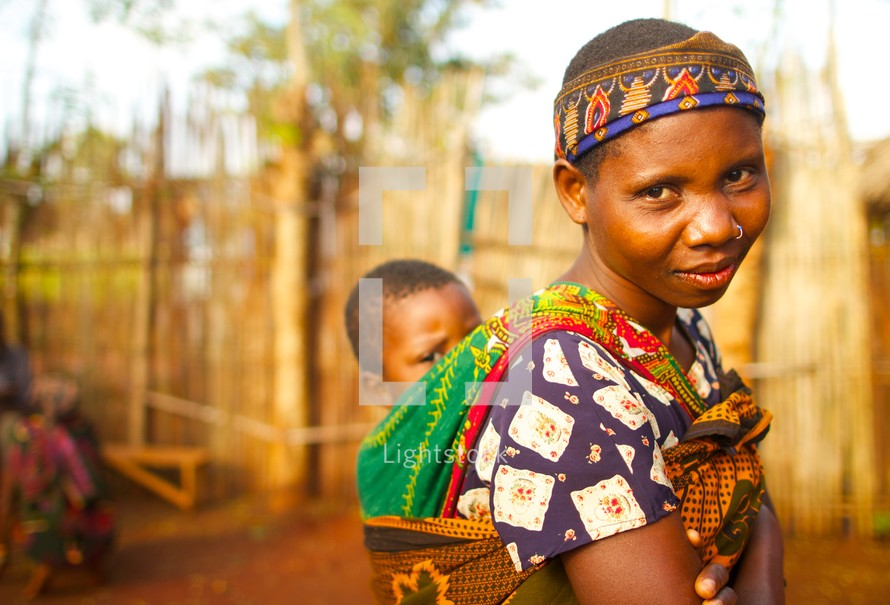 young African woman with a baby on her back