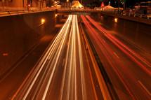 streaks from headlights in heavy traffic at night