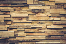 layered wood boards on a wall