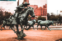 ranches and cattle statue