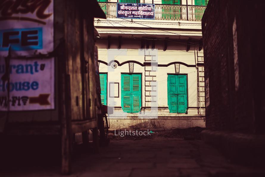 green shutters on buildings
