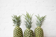 a row of three pineapples