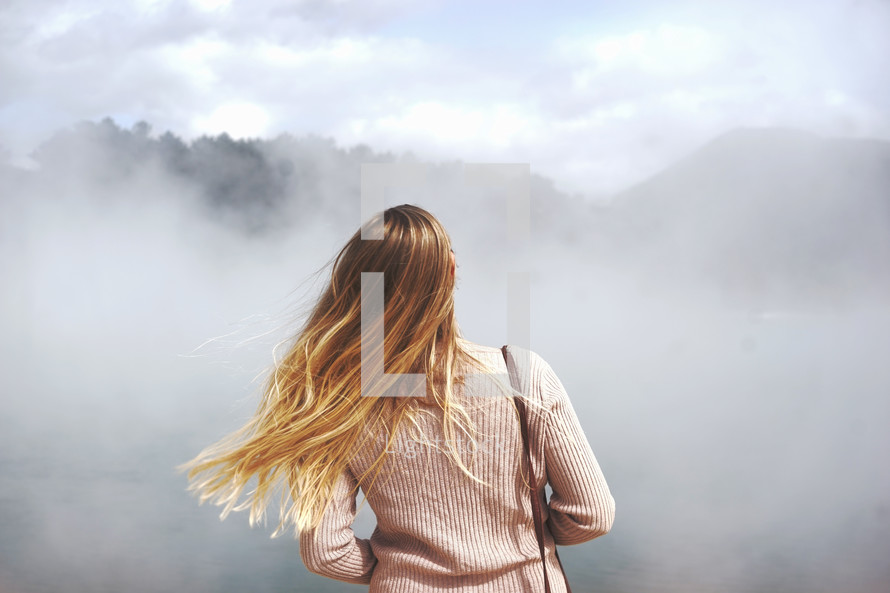 a woman standing in fog