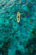 a man paddling a kayak in Haiti