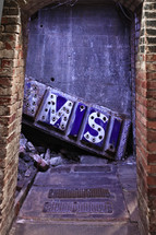 old rusty sign in alleyway