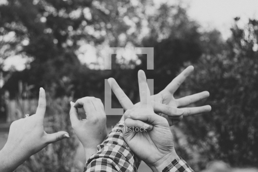 hands making the word LOVE
