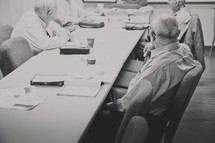 elderly men at a table for Sunday School