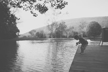a toddler boy fishing on a dock