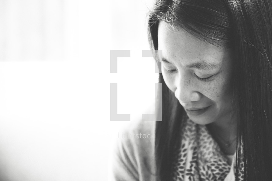 Asian woman with closed eyes