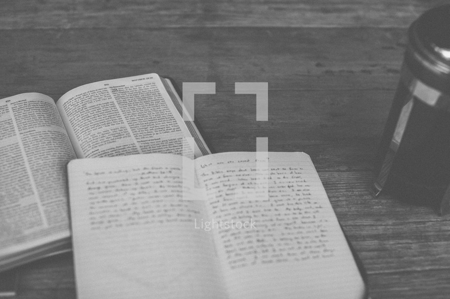 An open Bible, notebook and french press