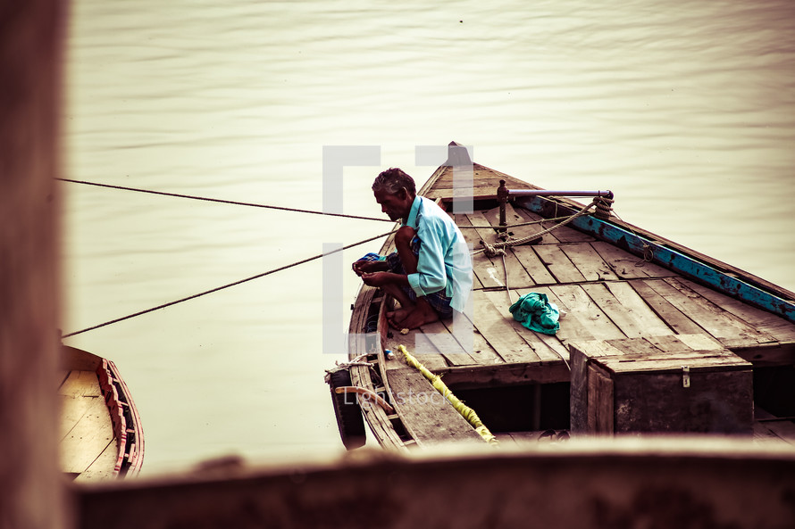 a man on a fishing boat