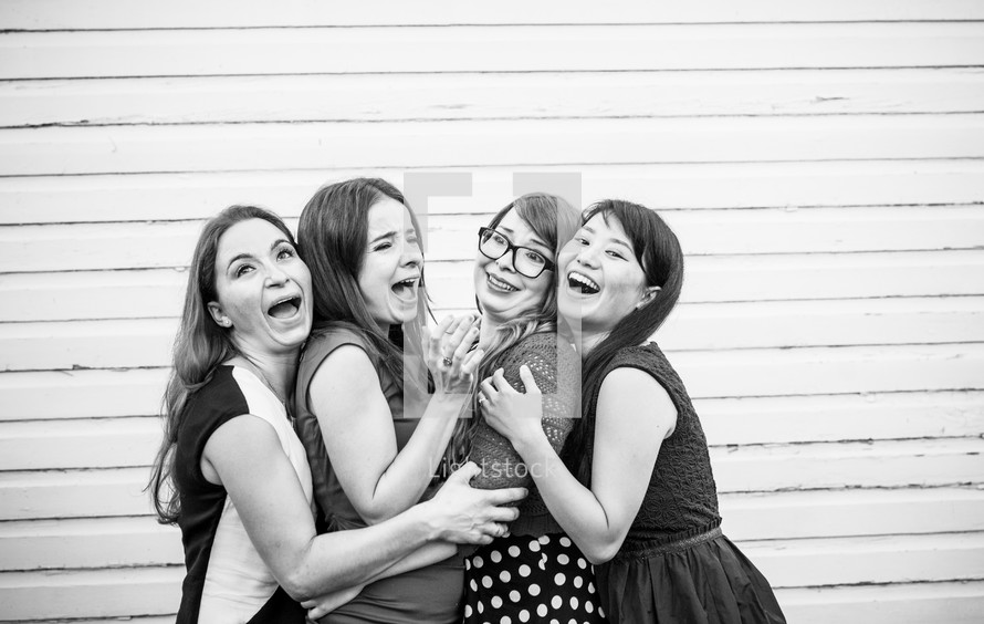 women hugging and acting silly