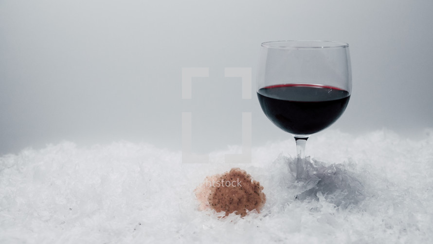 bread and wine on snow