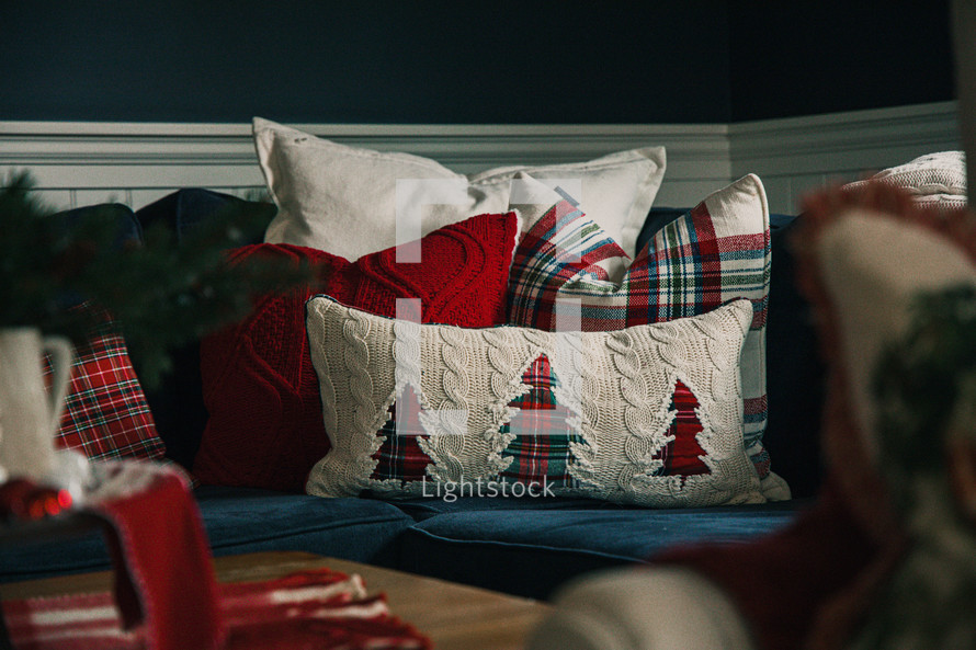 Christmas throw pillows on a couch