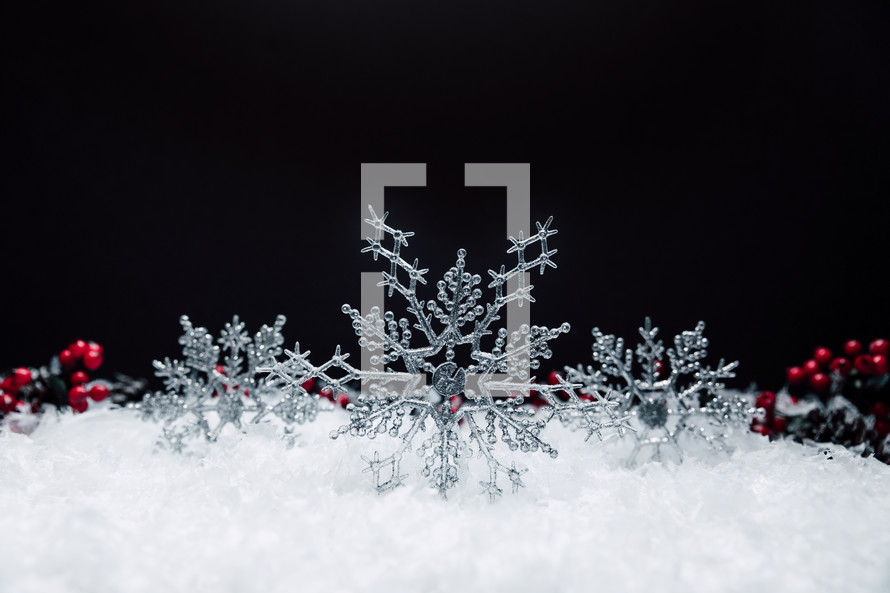 snowflake Christmas ornaments in snow