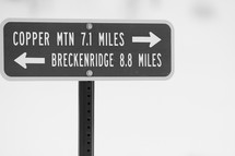 milage sign for Breckenridge and Copper Mountains