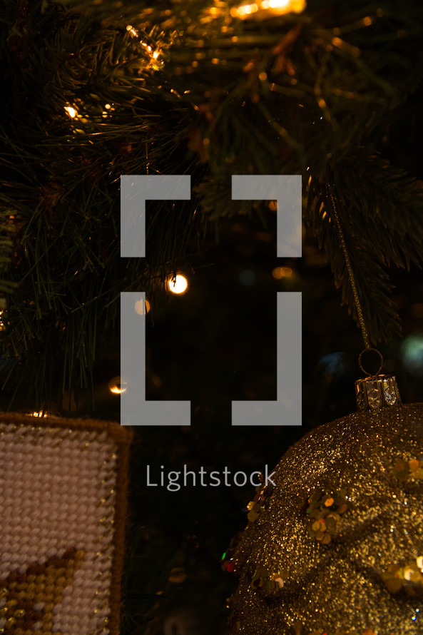 gold ornaments on a Christmas tree