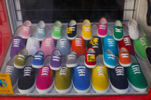 Colorful tennis shoes in store window
