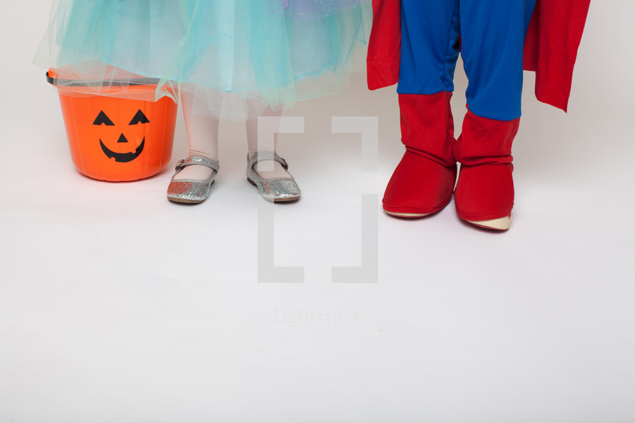 feet of children in Halloween costumes