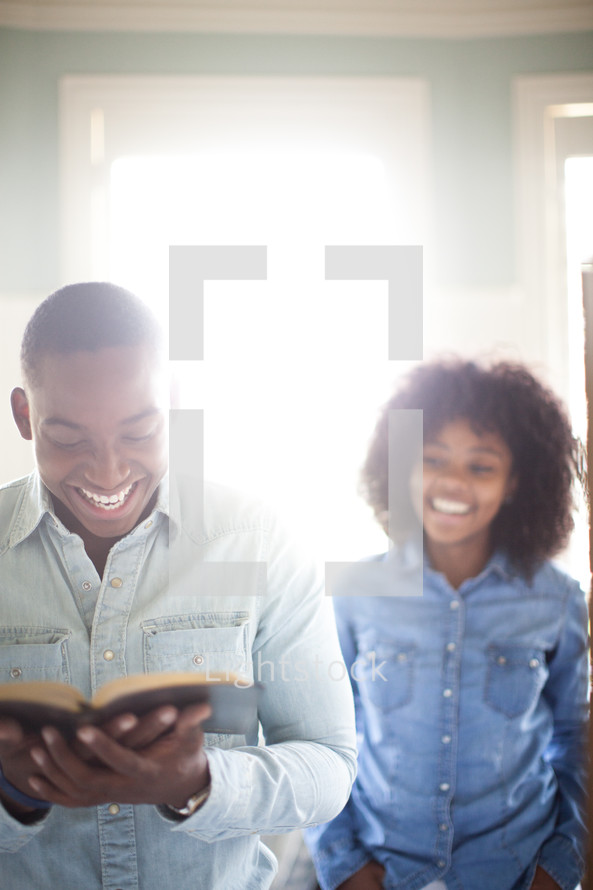 a couple reading a Bible together