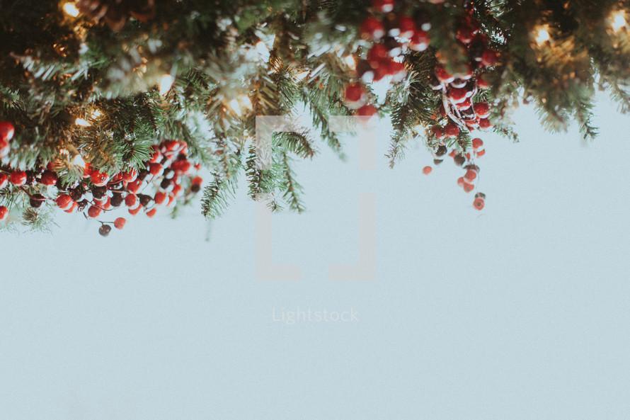 A Christmas garland border on white
