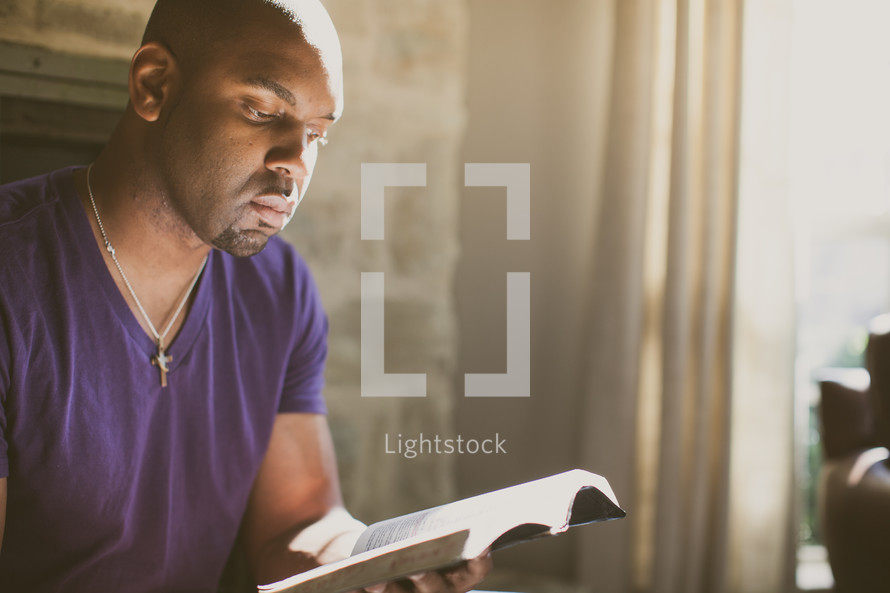 African-American man reading a Bible