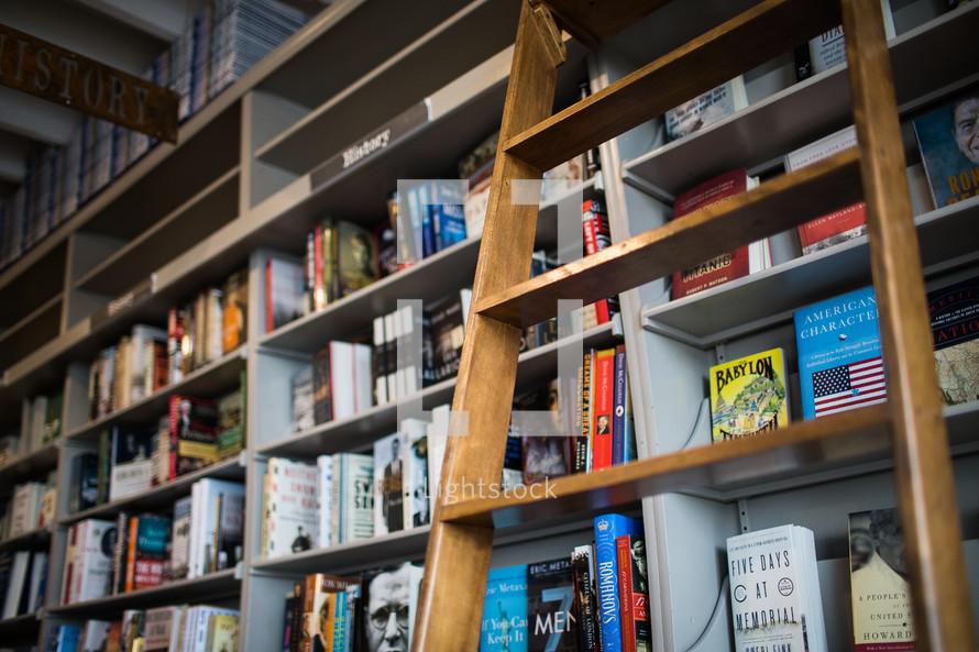 a ladder against a bookshelf