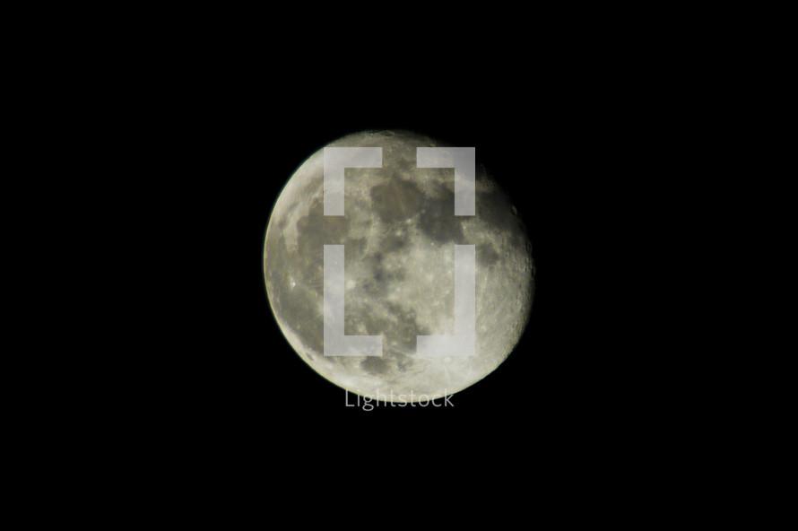 A near full moon on a clear dark night