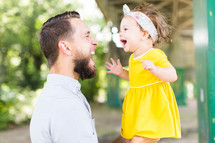 a father and daughter having fun