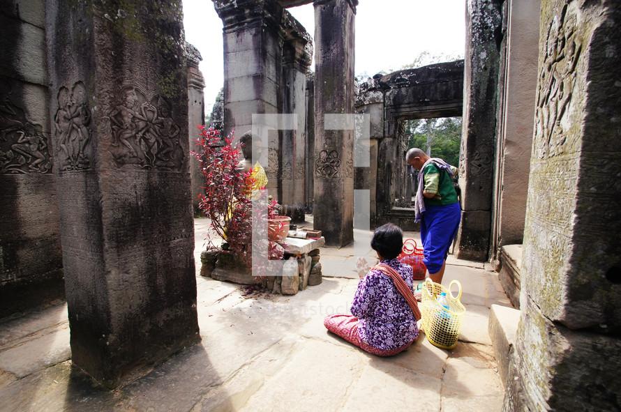 Buddhist prayer in ancient temple