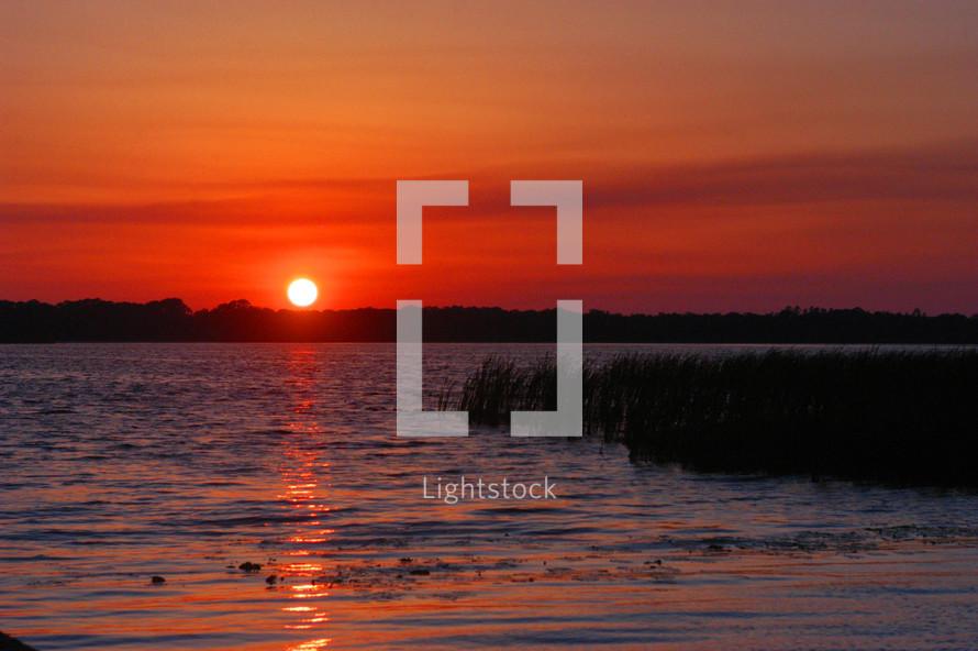 Early morning sunrise over a lake
