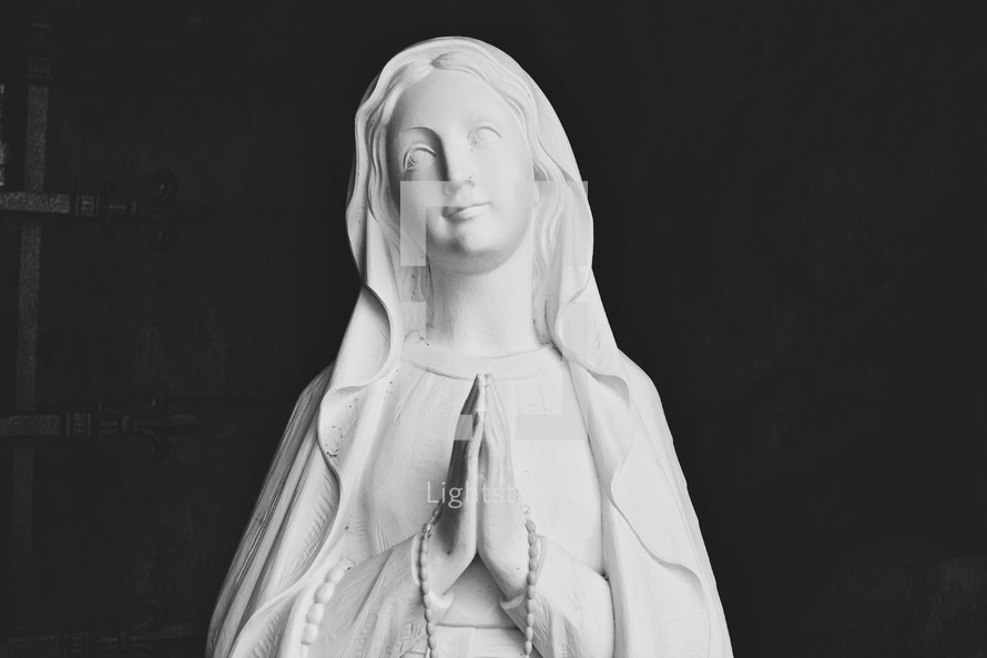 head of a statue of Mary praying