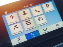 Smart multimedia in-car display with hands-free phone control. Modern navigation device on center of the car control panel.