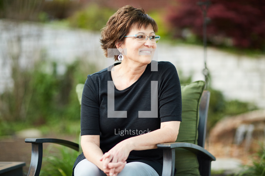 a woman sitting outdoors relaxing