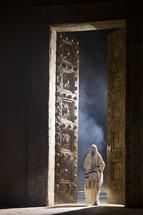 man entering temple doors