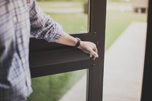 man holding open a door
