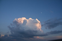 cumulus clouds and the distant moon