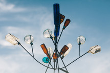 glass bottles on a metal sculpture