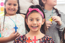 girls holding handmade crosses