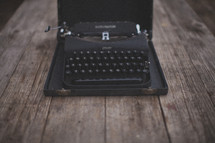 A vintage typewriter on a wooden table