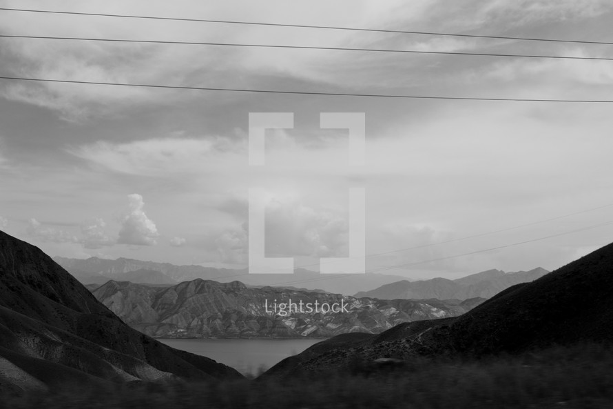 power lines and mountains and lake