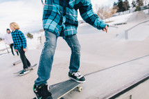 teen boys on skateboards at a skate park