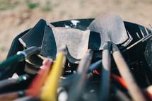 shovels in a wheelbarrow